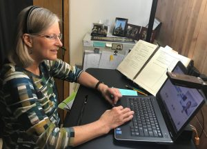 Shows Darlene tutoring a student via a Zoom video conference.