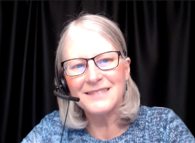This is a picture of Darlene with her headset one, ready to tutor.
